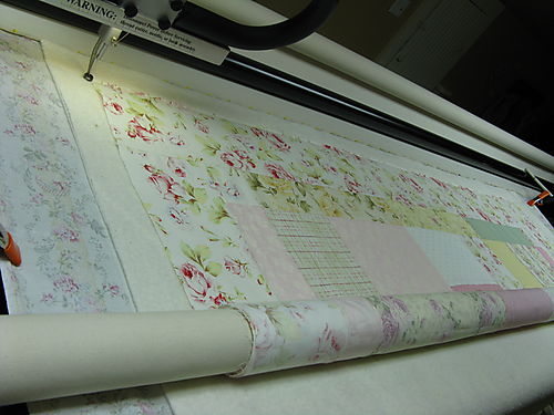 Stitiching the backing, batting, and quilt top down