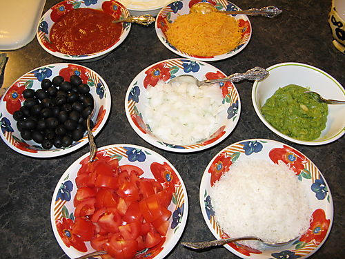 Bowls of add on to Mexican Pile-on