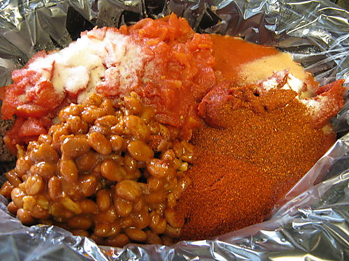 Canned tomatoes, tomatoe sauce, tomatoe paste, garlic salt, chili powder, and ranch style beans