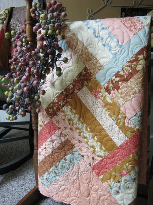 Field of Flowers Allspice Tapestry quilt on rack